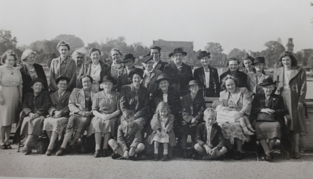 Picture of womens social hour in 1945 in a park.